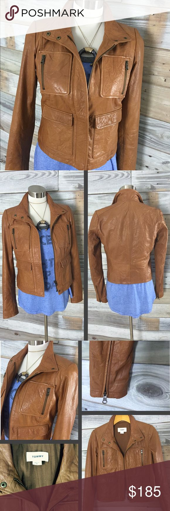 {Tommy} NEW Tan/Camel Genuine Leather Moto Jacket Absolutely GORGEOUS NWOT piece that every woman needs in her closet! (Well, one in black too...) beautiful buttery soft genuine leather in a deep camel tan color. Nice long sleeves w/ zippers to enable easy layering...2 zippered pockets on either side of breast and 2 flap pockets beneath those. Zips up front/side moto style, & 2-button banded collar (optional stand up when closed); all-around gorgeous jacket. Looks amazing with dress & boots…