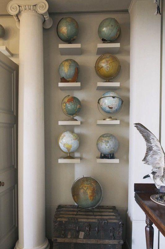 Display the globes we already have in the office on small shelves  Would love to do this going up the stairs!