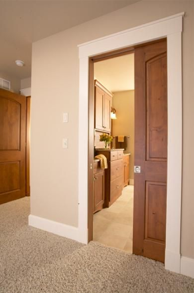 White trim wood pocket door like it home sweet home for Wood doors with white trim pictures