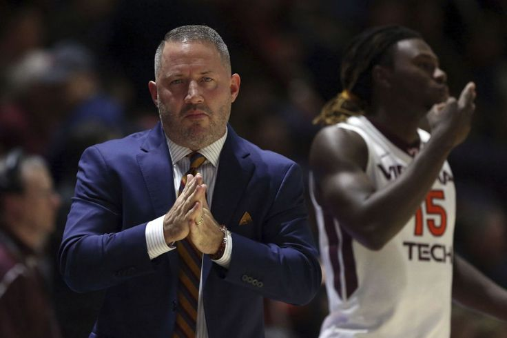 Hill carries Virginia Tech past cold-shooting Hawkeyes