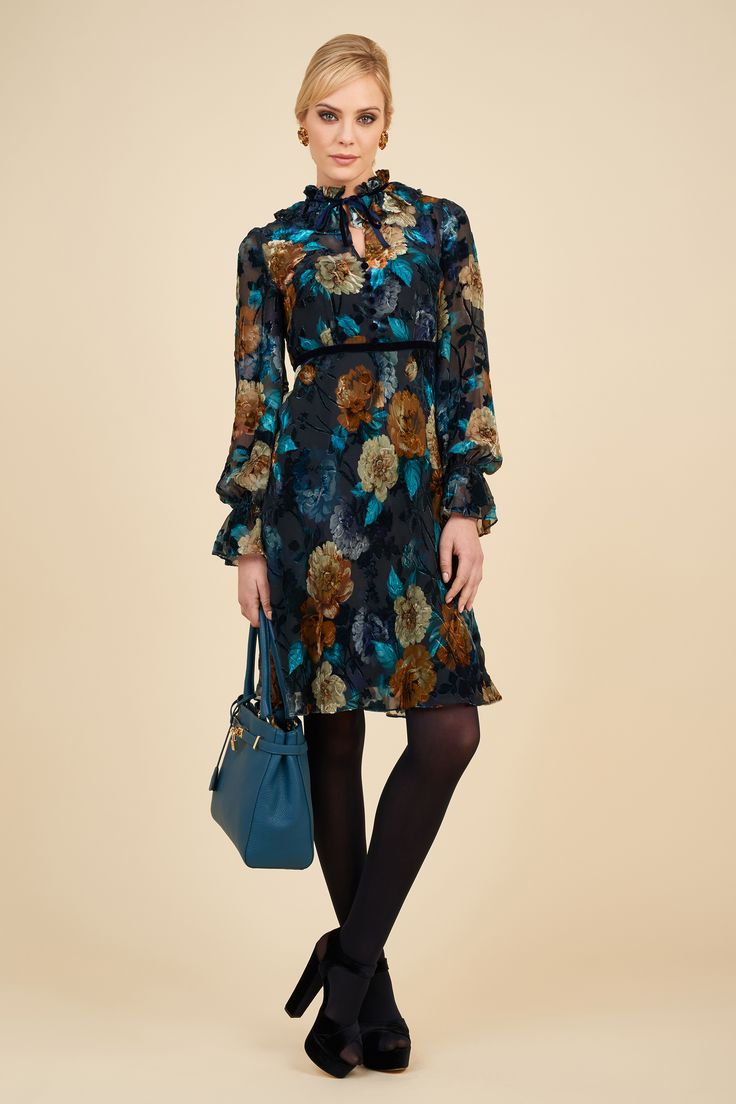 Printed devoré velvet dress with Impatto bag.