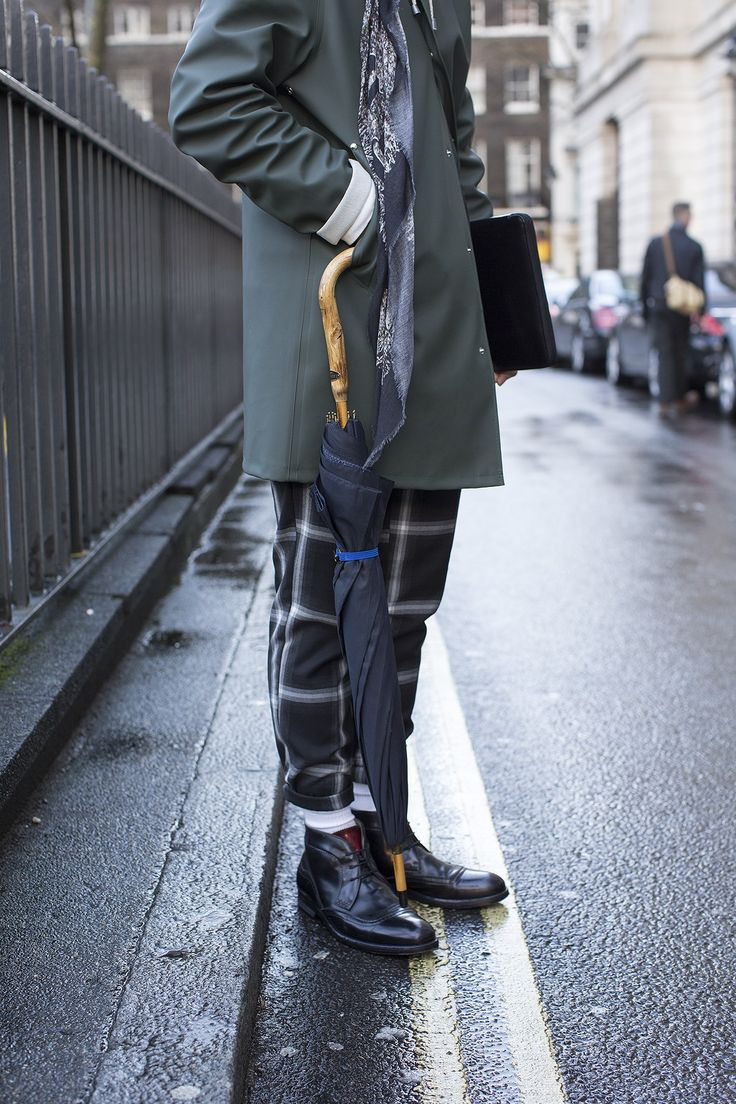 Wearing a Uniqlo hat and roll neck, Christopher Kane jumper, Topman trousers, Stutterheim coat, Oliver Sweeney boots and carrying a Ted Baker Brolly and Comme des Garcon folio.