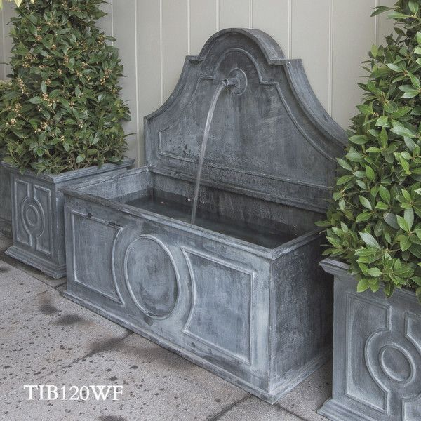 You can source similar water features from Bulbeck Founderies or Capital Garden Products make faux lead water features - Tiber