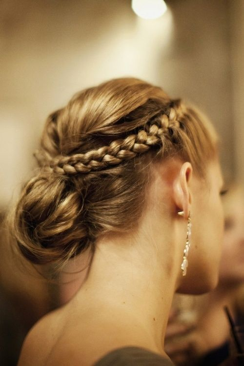 Beauty Tip: Crown French Braid with casual bun  You Need: Comb, Clear Elastics, Bobby pins, Hairspray, Pequi   Step 1: Start w day-old hair   Step 2: From ear to ear, create a section 2.5 in frm hairline   Step 3: Starting in middle, create 2 French braids 2 in from hairline  Step 4. Secure & dab hairspray along braids  Step 5. Lightly tease crown, then smooth  Step 6. Twist this section & pin at back of head, including braids in pins  Step 7. Pull rest of hair into mussed bun & secure