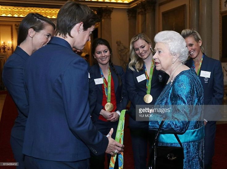 British Olympic womens hockey team players react as they talk with Britain's Queen Elizabeth II, during a reception for Team GB's Olympic and Paralympic athletes, at Buckingham Palace in central London on October 18, 2016.Britain's stars of this year's Olympic and Paralympic Games in Rio attended an 'amazing' reception at Buckingham Palace -- the official London home of Queen Elizabeth II -- on Tuesday. / AFP / POOL / Yui Mok        (Photo credit should read YUI MOK/AFP/Getty Images)