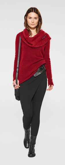 Outfit by Belgian fashion designer Sarah Pacini. Strawberry red assymetric sweater with draped collar and black pants. I love the way the pants drape repeat the drape line of the sweater.