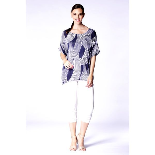 Flowy line details adds an extra dose of chic to this elegant travel-friendly pattern top.  Content: 100% Polyester  Fit: Regular