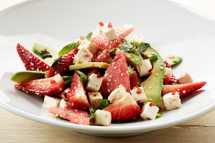 Juicy summer salad with strawberries, watermelon, avocado and feta