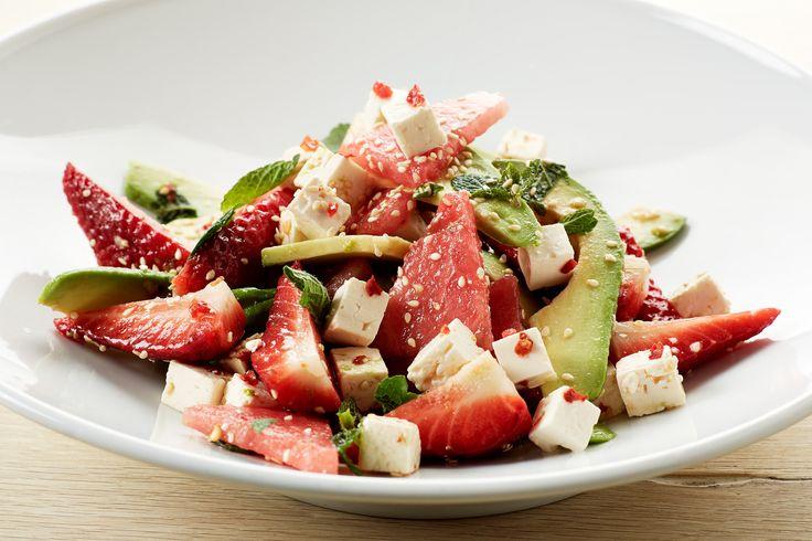 Juicy summer salad with strawberries, watermelon, avocado and feta