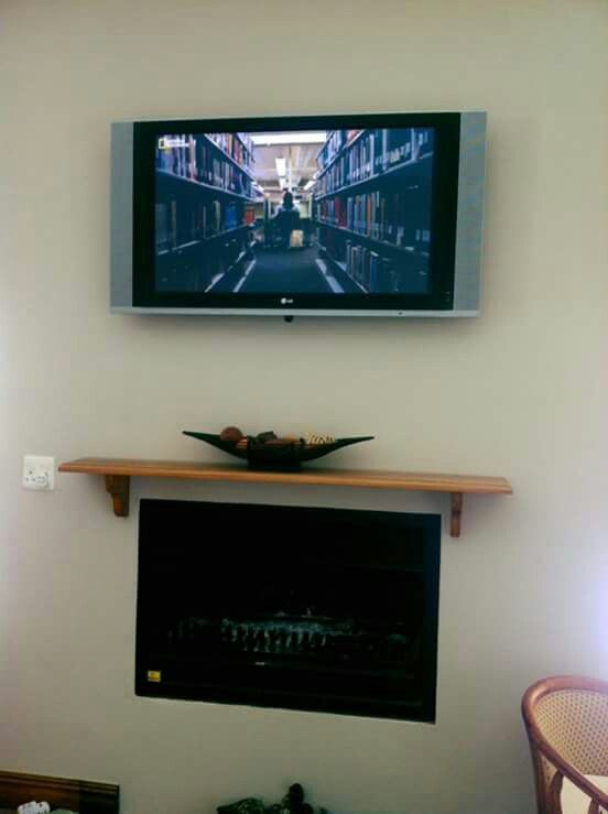 TV wall mounted above fireplace. Connected to DSTV HD 4U decoder via hdmi over cat6 converter.