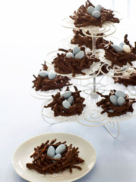 """Nest Eggs  A package of crunchy wonton noodles, melted chocolate, and some Jordan almonds are all you need to create these tasty treats. In a bowl, toss noodles with melted chocolate and use your hands to form nest shapes with an indentation in the center. Work quickly and in batches to form nests before the chocolate sets. Set on waxed paper to dry. Serve with a few Jordan almond """"eggs"""" in each nest."""