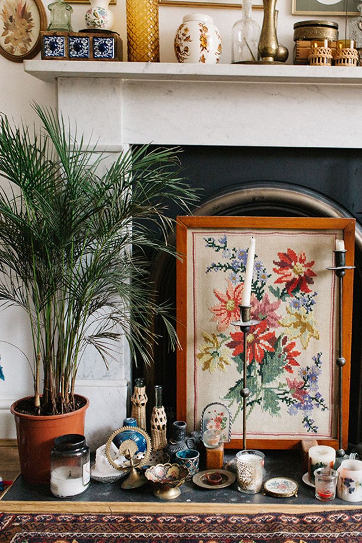 Cover your fireplace in mismatched objects for an eclectic vibe.