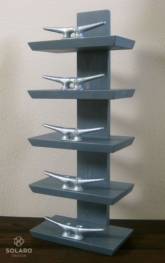 Nautical-themed wine rack with 6 cast iron dock cleats to secure 6 bottles in place. Best for wine you wish to preserve while displaying the labels.