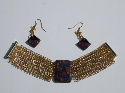 European chain maille cuff with polymer clay focal, and earrings to match!