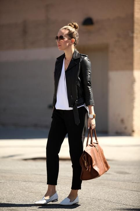 Blogger Brooklyn Blonde in black pants, a leather jacket, and loafers