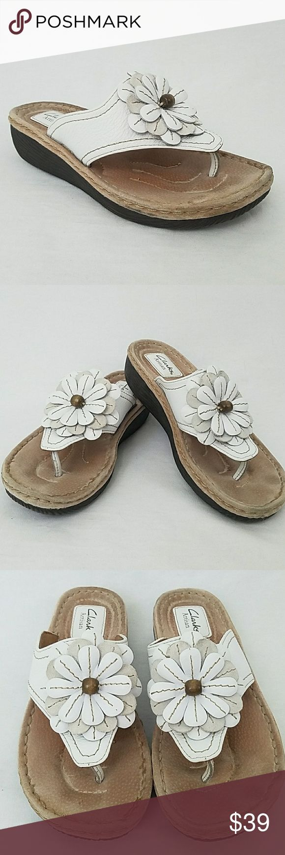"Clark's Artisan Size 7-1/2 White Flower Sandals Brand: Clark's Artisan Collection Condition: Excellent Preloved Color: White and Cream Style: Slip on sandal  Material: Leather Size: 7.5 M Heel Height: 1-1/2"" Insole: 9-1/2"" Special Accents: Adorable white flower decoration Issues: None Made: China Smoke Free Environment: Yes Clark's Shoes Sandals"