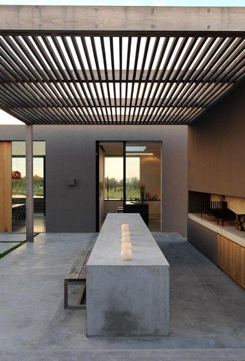modern pergola, entertainment space with concrete table