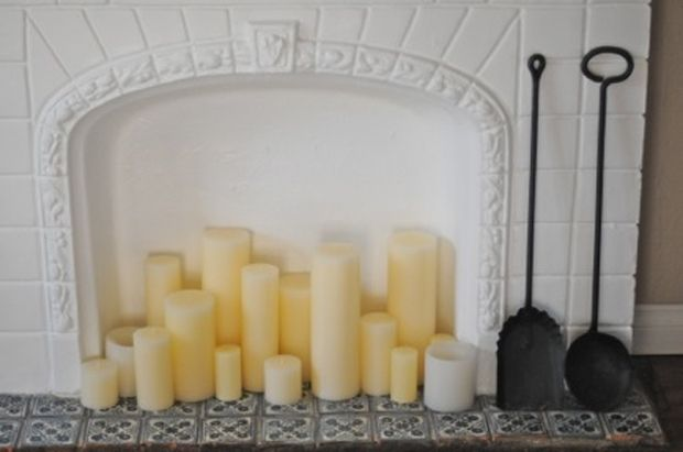 Fill a fireplace with chunky church candles