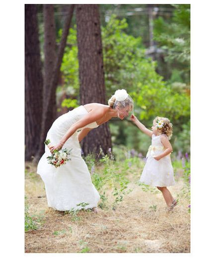 Lovely Ladies The rich and rustic woods make a picturesque setting for capturing a sweet moment between a bride and her petite pal.