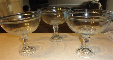 Dollar tree bowls + candle holders = huge glasses for candy buffet