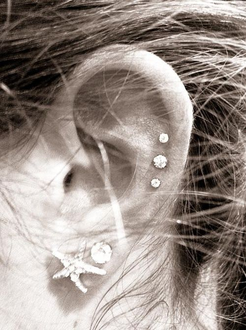 Love the Starfish and also placement of the top 3 earrings.  so cute!  Think its time for more piercings. . .