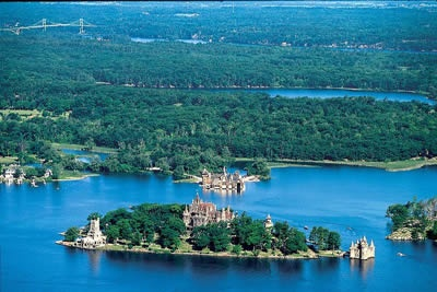 "This is where Canada and the US meet, their cultures blending in the waters of the St. Lawrence River and the Great Lake Ontario. The ""1000 Islands"" complex stretches 80 km downstream of Kingston and numbers over 1,864 islands both large and small.  I want to visit, in honor of Mom."