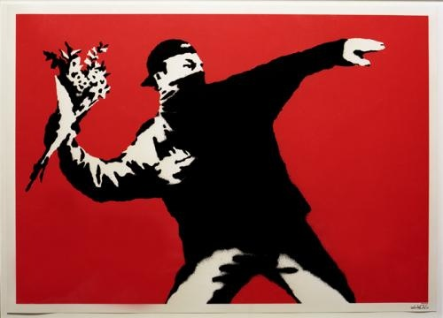 Banksy - Love is in the air by jaimesleggett, via Flickr
