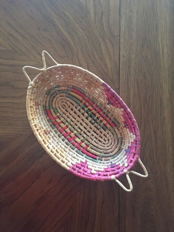 Vintage Southwestern basket. We LOVE this find! Could be used as a bread basket, organization, a linen closet... the possibilities are endless! Measurements L: 17 (from tip of handles), 14 (bowl) W: 9 1/2 D: 3