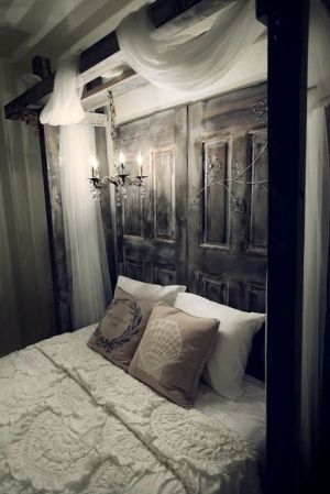 Oooh hold everything! I love that idea for a headboard! Two antiqued doors!! Now where to find a pair?