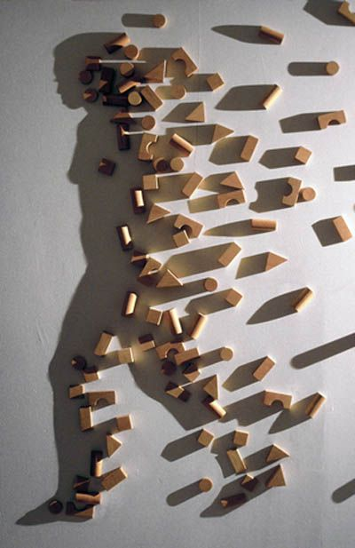 Even though this is not an actual man the shadow castes a portrayal of a man and the building blocks scattered around seem as an indicator of motion to the figure.    http://www.nobeliefs.com/puzzles/illusions.htm