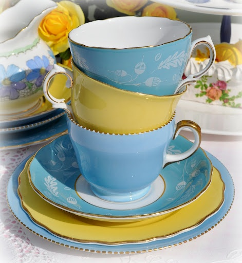 Pretty butter yellow and sky blue teacups.