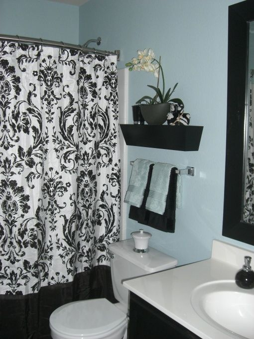 Blue/Black Bath, I wanted to brighten up my guest bathroom but at the same time make it cozy with clean lines. The paint color alone made the biggest difference but staying consistent with the three colors (blue/black & white) made all the difference. , Bathrooms Design