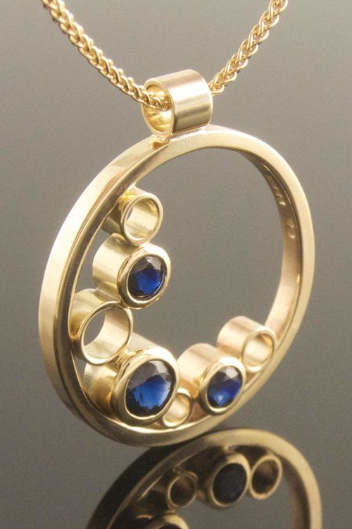 Recycled yellow gold and blue sapphire circle pend…