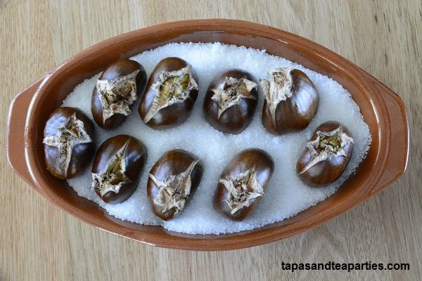 Chestnuts on a bed of salt roasted in our Bandeja Oval Tray.  Available on our website tapasandteaparties.com