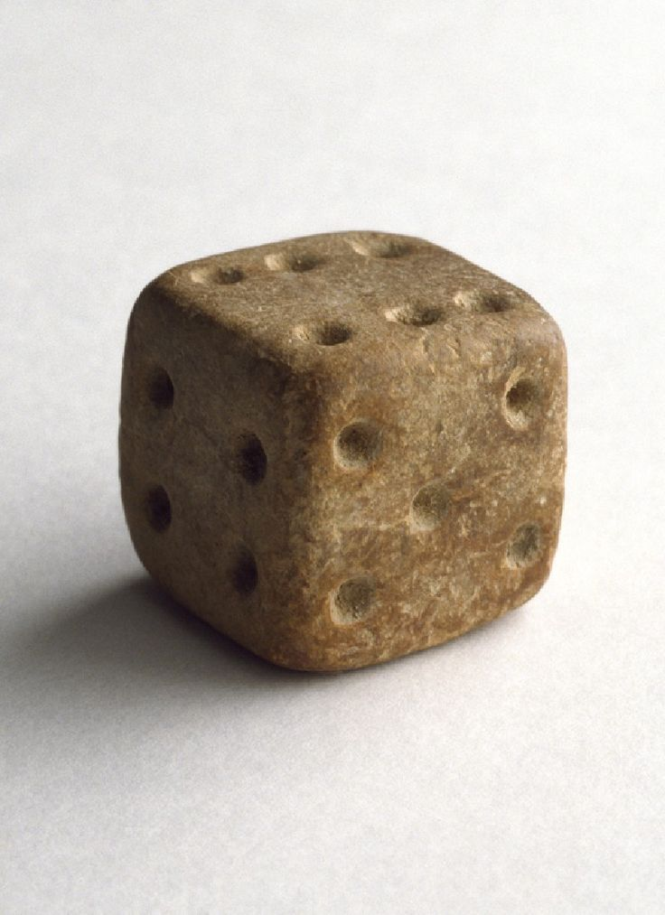 Terracotta dice  India 2500 - 1900 BC  Gaming with dice has always been popular in India. This Indus cubical die is unusual in that its opposite sides add up to seven as in modern dice.
