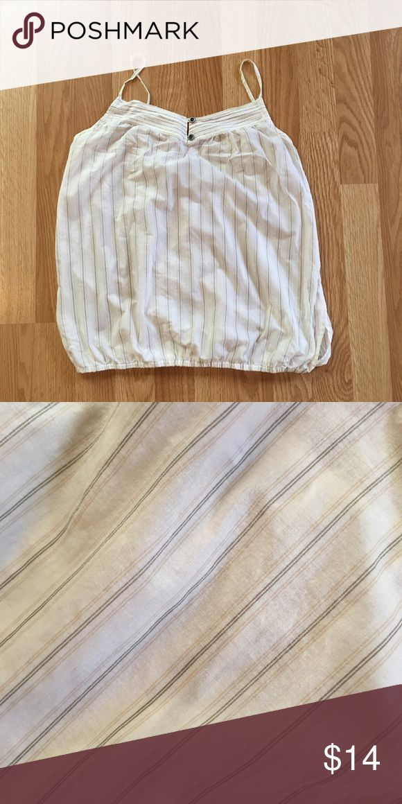Breezy Gap strappy top Super comfy and cute Gap tank top. Cream background with light tan and black stripes. Elastic bottom makes the top blouse out. Two small decorative buttons on the front. EUC GAP Tops Tank Tops