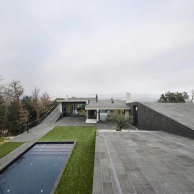 Bescano House: Location: Girona, Spain Year of Construction: 2011 Architects: Josep Ferrando Bramona  The Bescano House initiates different relationships with it's surroundings with the stimulating materials, incorporation into the landscape and spatial character.