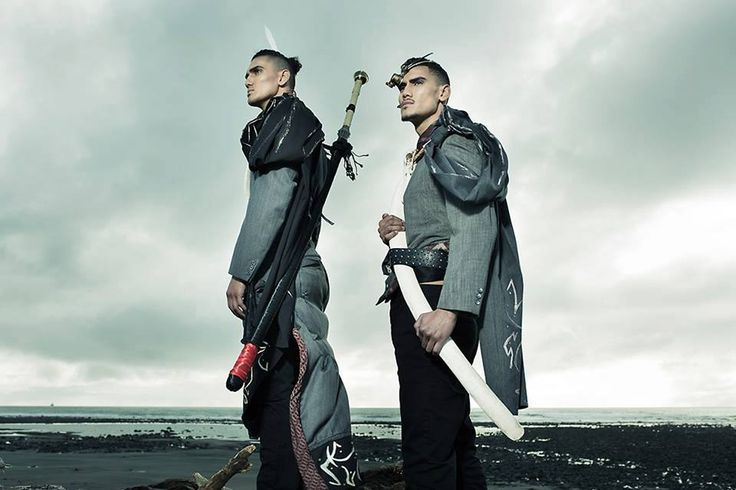 for INDIGENOUS RUNWAY PROJECT twin brothers pose wearing Corporate Pirates - Hand Sewn and Hand Painted featuring steampunk eye piece from Karan Hansen and bone Jewellry from Suzanne Tamaki. Whale Rib Bone on loan from Vic Biddle  Six Foot Asian Sword David Roil original photo Mark Harris