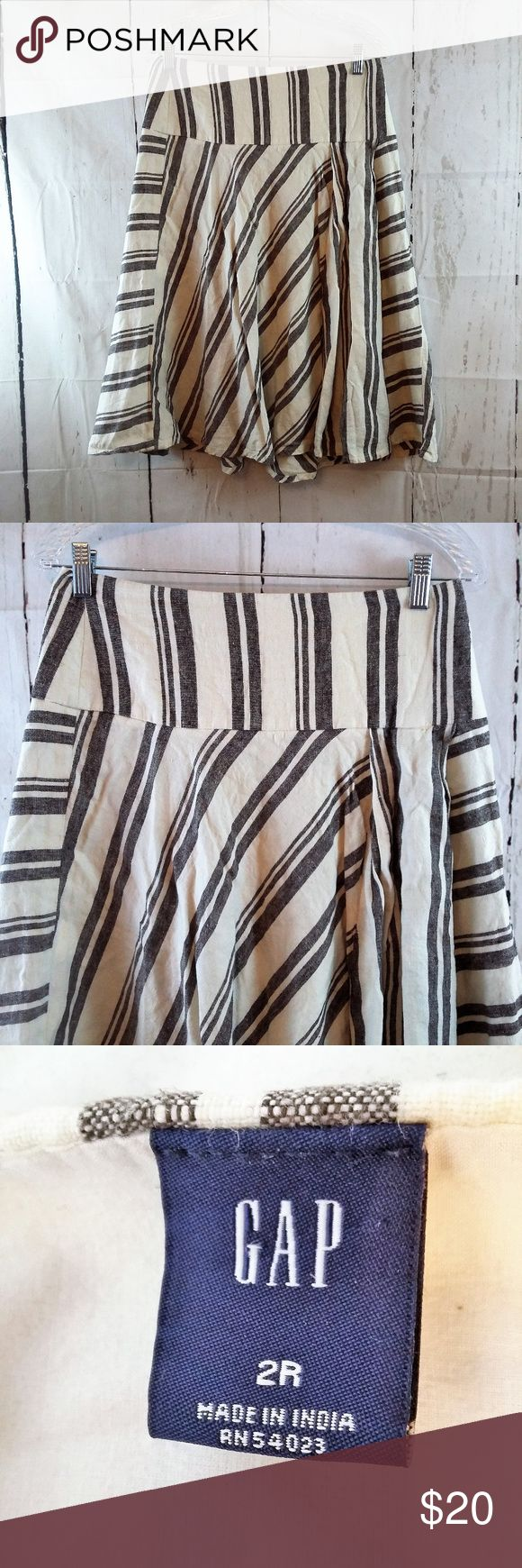 """Gap Size 2R Gray White Striped 100% Linen Skirt Gently used, clean and in good pre-owned condition.  Waist = 15"""" (hip - hip - across the front) Length = 26.5"""" (hip to hem) Material: 100% Linen Features: A-line, hidden side zip, thick, flowy  No trades or modeling of clothing, jewelry, shoes or accessories.  If additional measurements are required to ensure the perfect fit for you, I will gladly provide them. All items are from a smoke-free/pet-free home. GAP Skirts"""