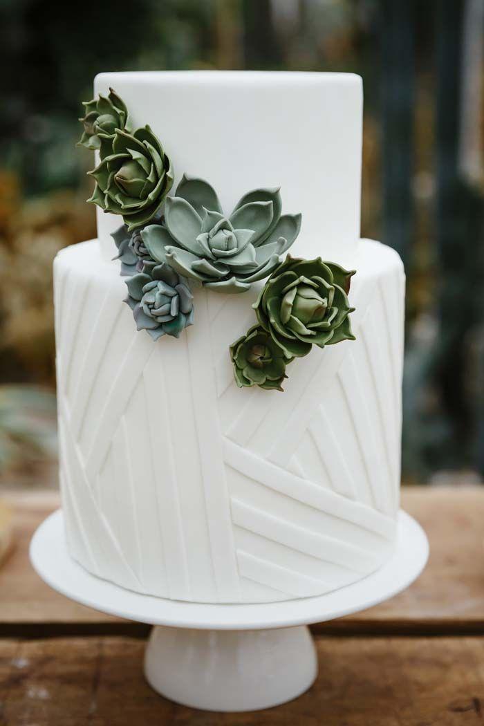 Very cool wedding cake! I love how it combines geometrics and succulents.