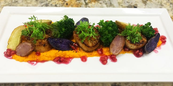 Seared Scallops, Carrot-Ginger Puree, Sauteed Broccoli, Roasted Tricolor Baby Potatoes, Pomegranate Sauce, Micro Carrot Tops