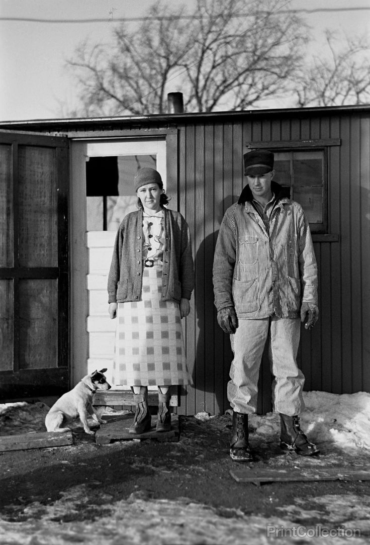 Mr. and Mrs. Marcus Miller and dog, Spencer, Iowa photographed by Russell Lee in December of 1936 on 35mm nitrate film.