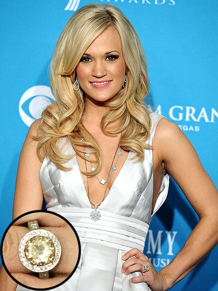 Country Star Carrie Underwood's engagegement ring from her now-husband Mike Fisher is a flawless yellow diamond estimated to be worth one hundred and fifty thousand dollers. You go girl!
