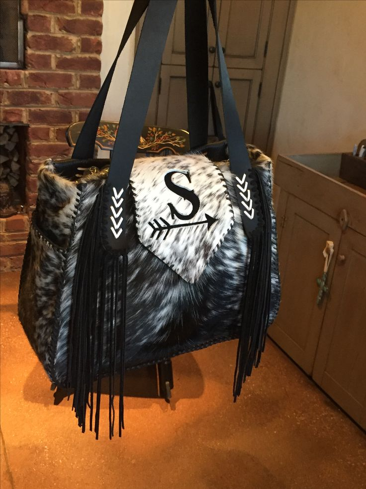 The Bonnie Bag, with side pockets lined in suede, straps with side fringe and the owners initial on the flap. Custom purses and totes from gowestdesigns.us