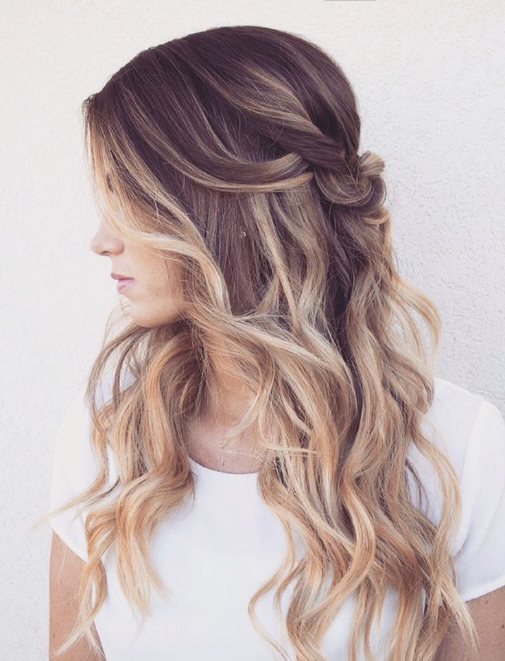 This balayage ombre faded hair color is beautiful. The long layers, curls, and half up-do finishes this look.: