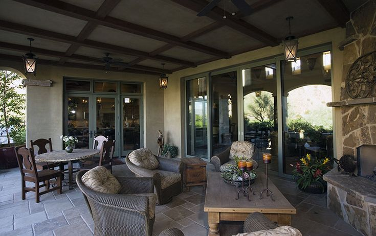 beautiful-covered-patio-with-stone-fireplace-and-furniture