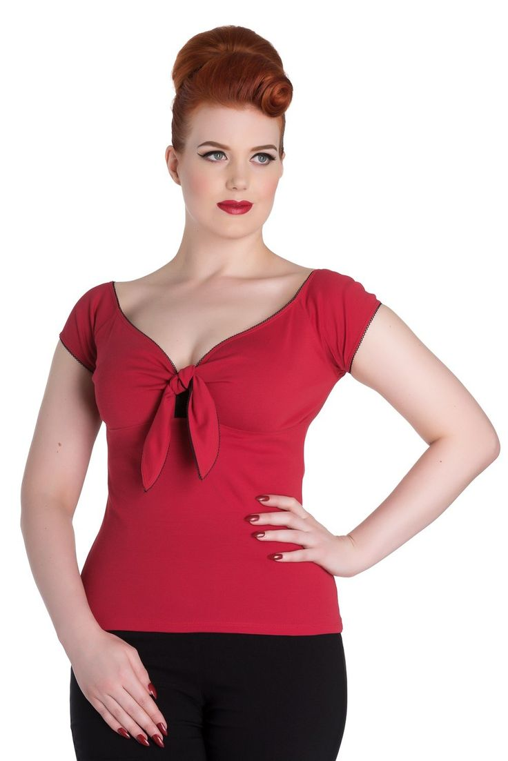 The Bardot Top has arrived!  DESCRIPTION  Stretch top. Ties at the centre front. Short sleeves. Looped trim on the neck edge and the sleeve opening. Low curved back neck. Pair with our Joanie Pencil skirt for a classic rockabilly look! Fabric content: 100% Cotton.