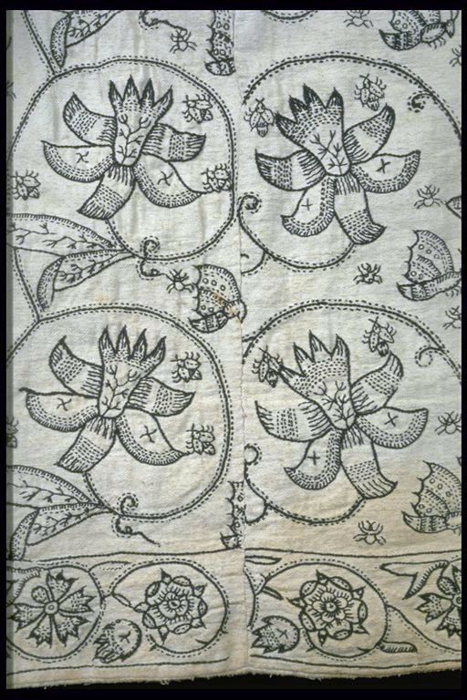 Skirt  A rare woman's skirt made from fustian, a mix of linen and cotton, and embroidered with large floral patterns.  1621-1640  ID no:  59.77b  Museum of London  Detail