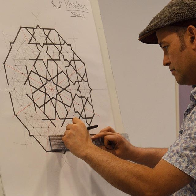 Our geometry tutor Richard Henry teaching an Alhambra pattern here in Spain on our Granada study trip.