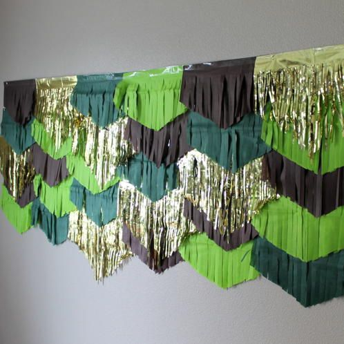 This tissue garland backdrop is great for your where the wild things are party or any other jungle or earthy themed party. This set includes 5 garlands with the colors shown. Brown, Lime, Forest Green and Metallic Gold accents. Each peice is cut into a chevron shape after it has been hand fringed. Patterns are irregular and each garland is two sided for the maximum pattern variety. Hang each garland horizonal in layers from bottom to top using tape or tacks. Or hang vertically